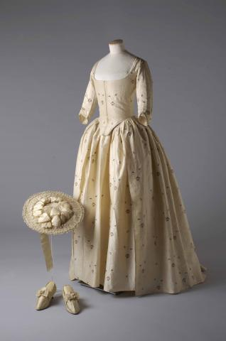 Weddings_V%26A_Silk_brocade_gown_hat_and_shoes_1780._permission_of_the_Olive_Matthews_Collection_Chertsey_Museum._Photograph_by_John_Chase.jpg